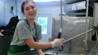 Estrella, doing dishes at the campgrounds