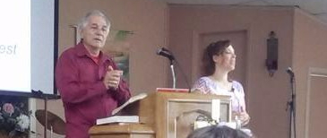 Translating for my Father, Rev. Mario A. Cintron. We make an awesome team.